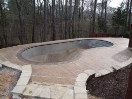 Aslar stamped patio with mesa tan coping