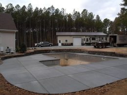 Broomed patio with EMl grey quartzite wall