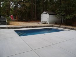 Broomed pool with small wall
