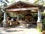 Covered pergola with stone bases and columns
