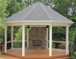 Gazebo with rot free trim, gutters, and metal balusters