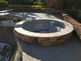 Hot tub surround with travertine caps
