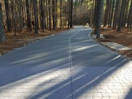 Long driveway with grey cobblestone stamp in front