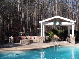 Neighbors pergola wall and firepit