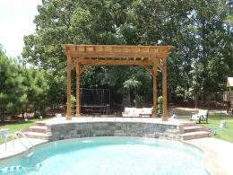 Pergola above raised water feature