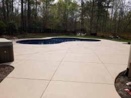 Pool patio with overlay and diamond joints
