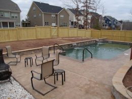 Slate stamped pool with wall behind
