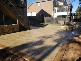 Spence stamped patio in large ashlar with smokey beige release