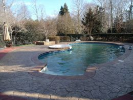 Stamped random stone patio with terra cotta stamped coping