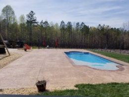 Stone texture stamped pool patio