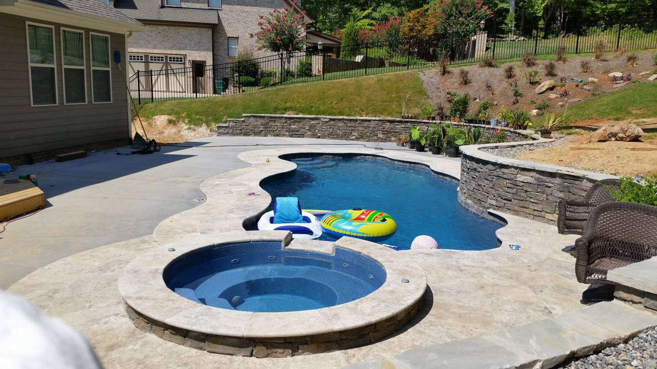 Travertine and broomed pool patio