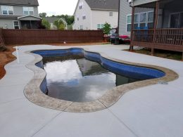Uncolored broomed poatio with smokey beige stamped coping