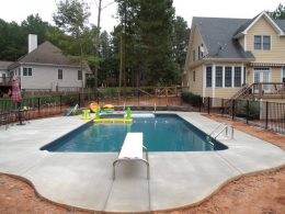 broomed pool with wall and bump out for diving board