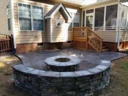hardscape seat wall and firepit with stamped patio