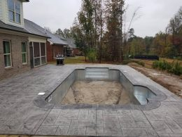 large ashlar stamped pool with medium grey coping