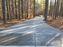 long driveway with grey cobble stamp in front
