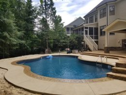 pool patio with integral color and stamped coping