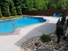 pool patio with medium grey stamped coping