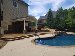 pool patio with water feature