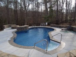 pool with retaining wall firepit water feature and seat wall