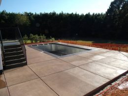 rectangle pool with colored concrete