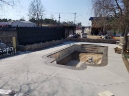 rising sun showroom pool with smokey beige stamped coping