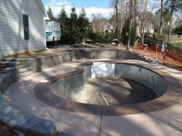 segmental wall with integral color and stamped coping