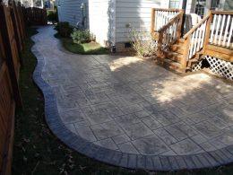 stamped ashlar patio with darker stamped brick border