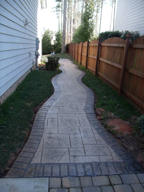 stamped ashlar slate walkway with stamped brick border