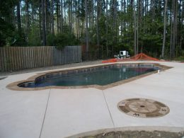 stamped coping and compass pool patio
