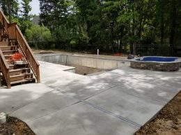 wake forest broomed patio with masonry hot tub