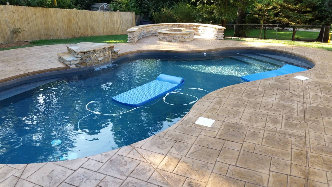 water feature and seatwall with firepit